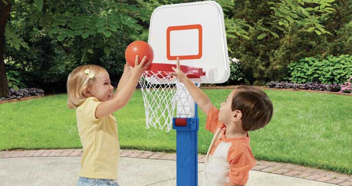 kid playing with basketball hoop